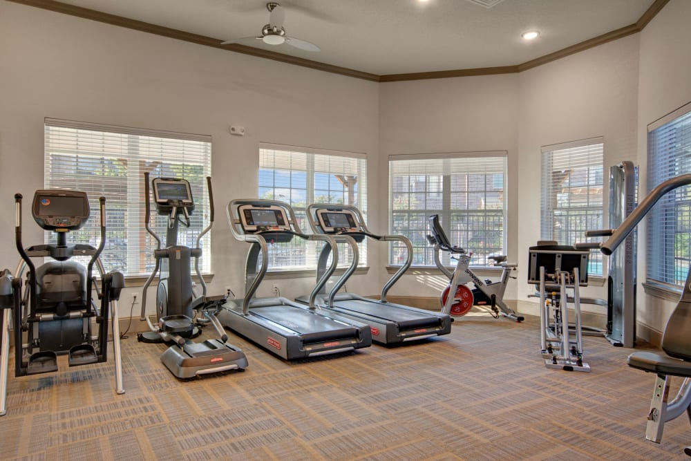 Workout equipment in the tall ceiling fitness center at Creekside South in Wylie, Texas