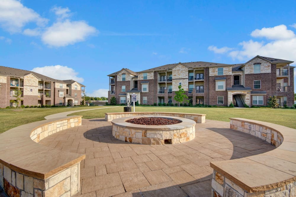 Outdoor fire pit by large grassy area at Creekside South in Wylie, Texas
