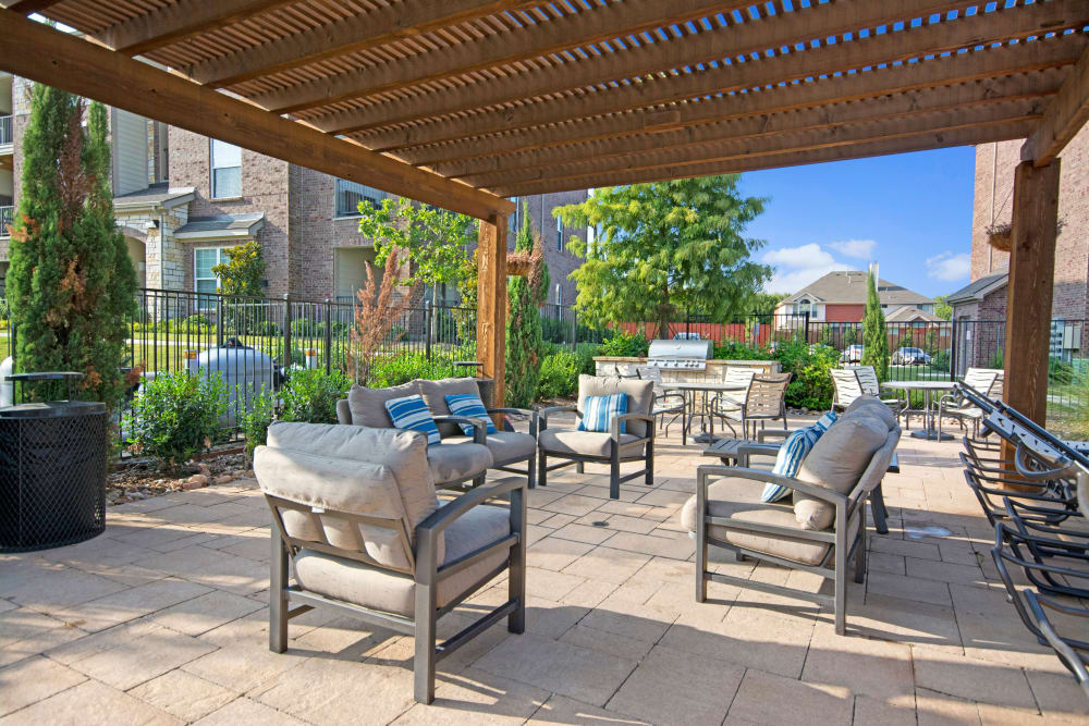 Outdoor community space featuring a shade gazebo and chairs at Creekside South in Wylie, Texas