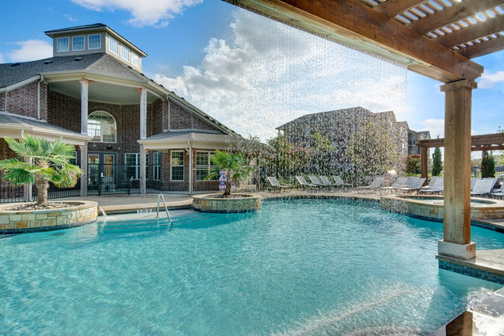 View of community Pool and Clubhouse from shade gazebo by pool at Creekside South in Wylie, Texas