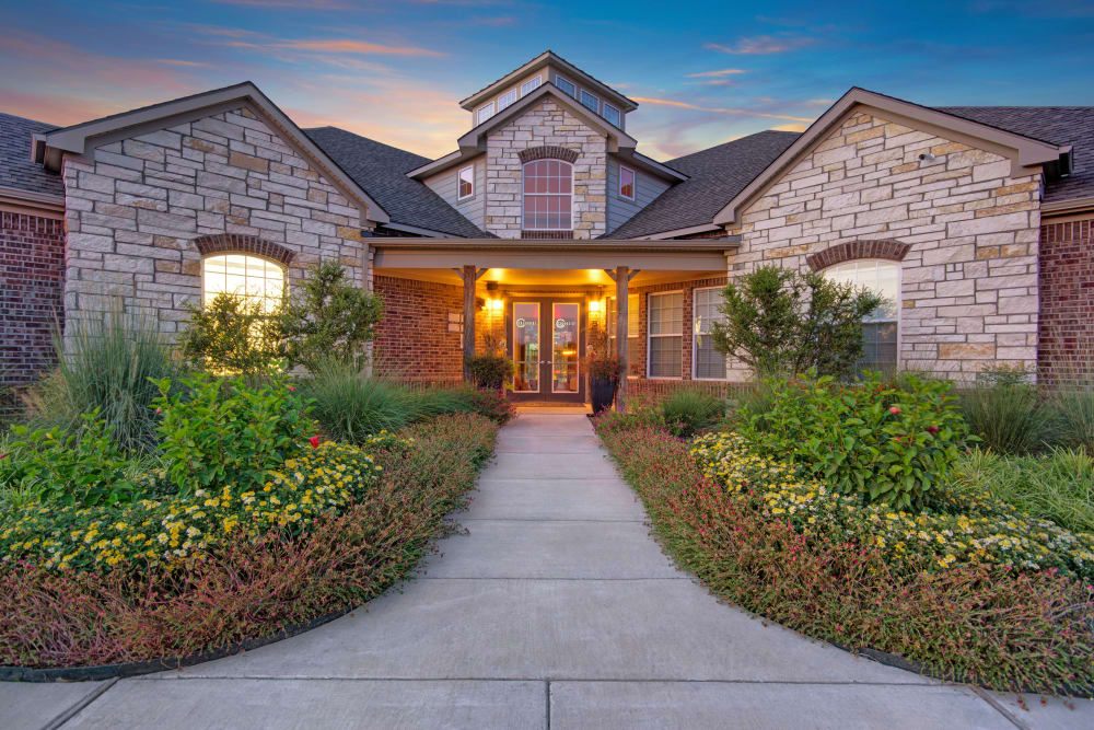 Clubhouse and leasing office with well tended Garden at Creekside South in Wylie, Texas