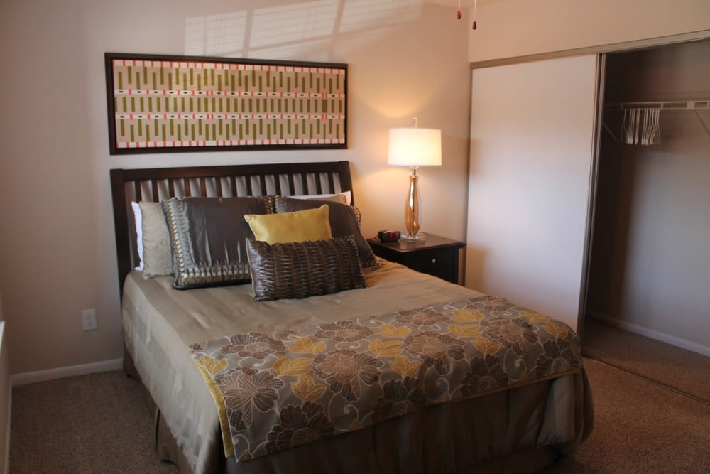 Well decorated model bedroom at The Reserve at Windmill Lakes in Houston, Texas