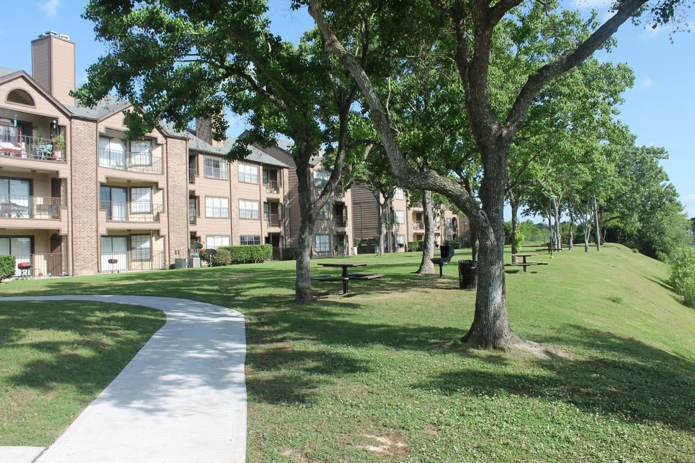 Exterior view of complex at The Reserve at Windmill Lakes in Houston, Texas