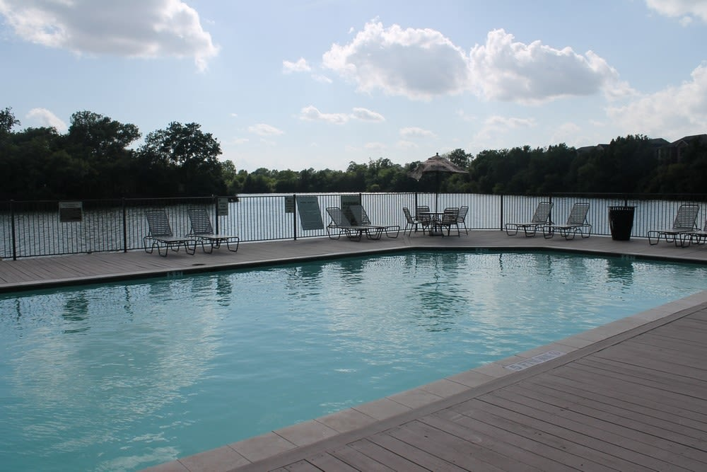 Lounge chairs poolside at The Reserve at Windmill Lakes in Houston, Texas