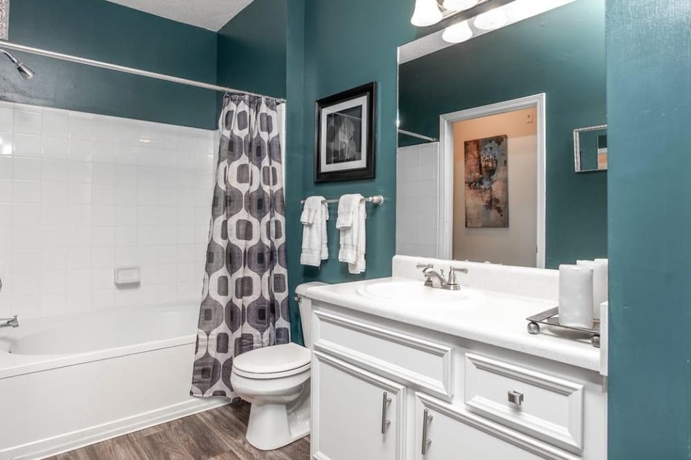 Bathroom featuring green walls and shower bathtub at Eastwood Village in Stockbridge, Georgia