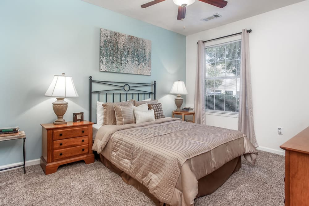 Bedroom at Eastwood Village in Stockbridge, Georgia features a blue-green accent wall