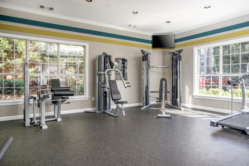 Spacious fitness room with lots of natural light from large windows at Eastwood Village in Stockbridge, Georgia