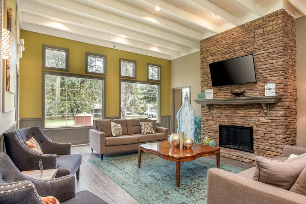 Clubhouse interior featuring a fireplace and comfortable sitting area at Eastwood Village in Stockbridge, Georgia