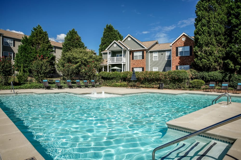 Outdoor community pool with apartments in the background at Eastwood Village in Stockbridge, Georgia