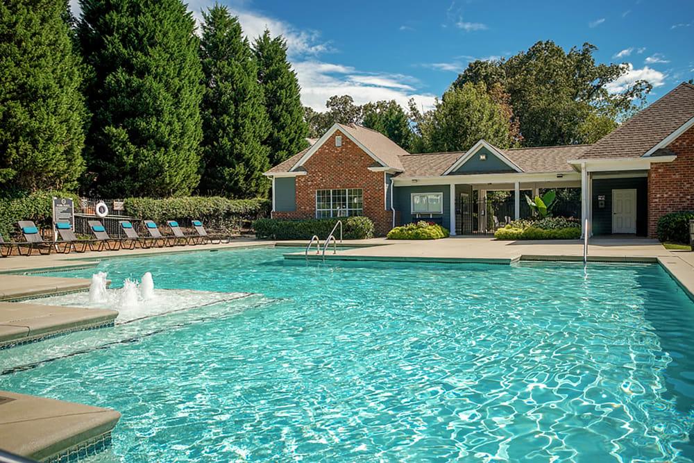 Community swimming pool features a splash fountain area at Eastwood Village in Stockbridge, Georgia