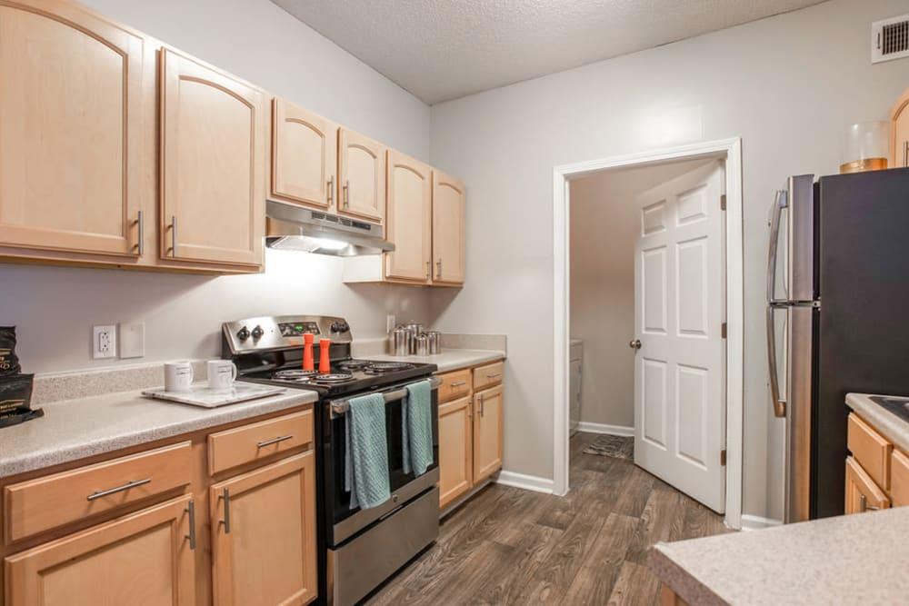 Modern kitchen with beautiful hardwood floors at Peachtree Landing in Fairburn, Georgia