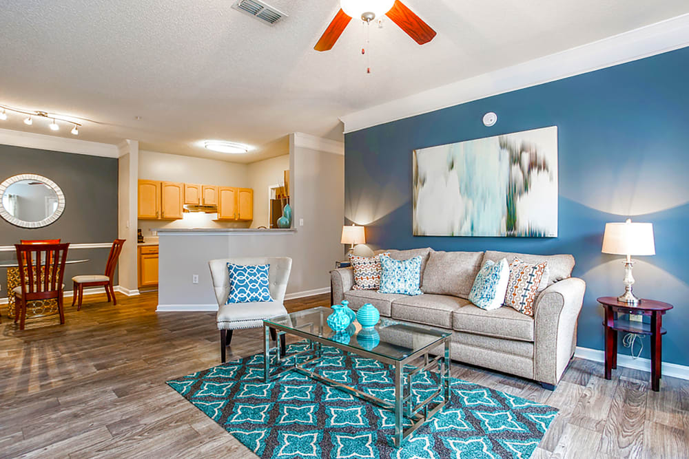Open concept floor plan with hardwood floors and modern decor at Peachtree Landing in Fairburn, Georgia