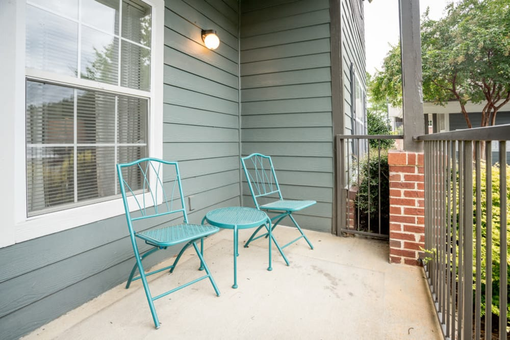 Unit porch with chairs at Peachtree Landing in Fairburn, Georgia