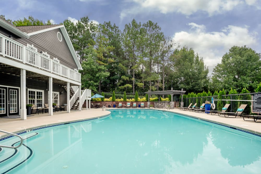 Resort style pool with lounge chairs at Peachtree Landing in Fairburn, Georgia