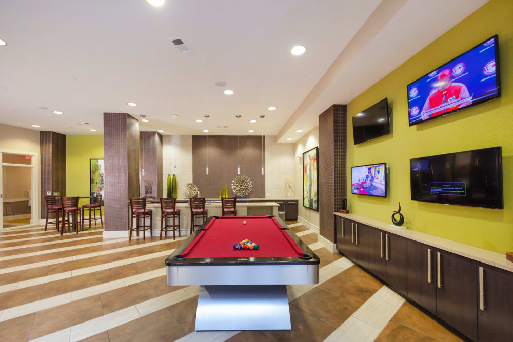 Clubhouse with pool table an TVs at Palette at Arts District in Hyattsville, Maryland