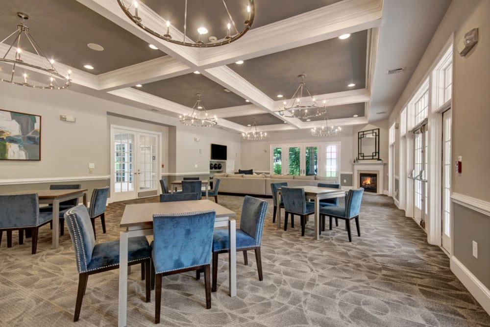 Tables and chairs offer a great community gathering space in the clubhouse at Frazer Crossing in Malvern, Pennsylvania