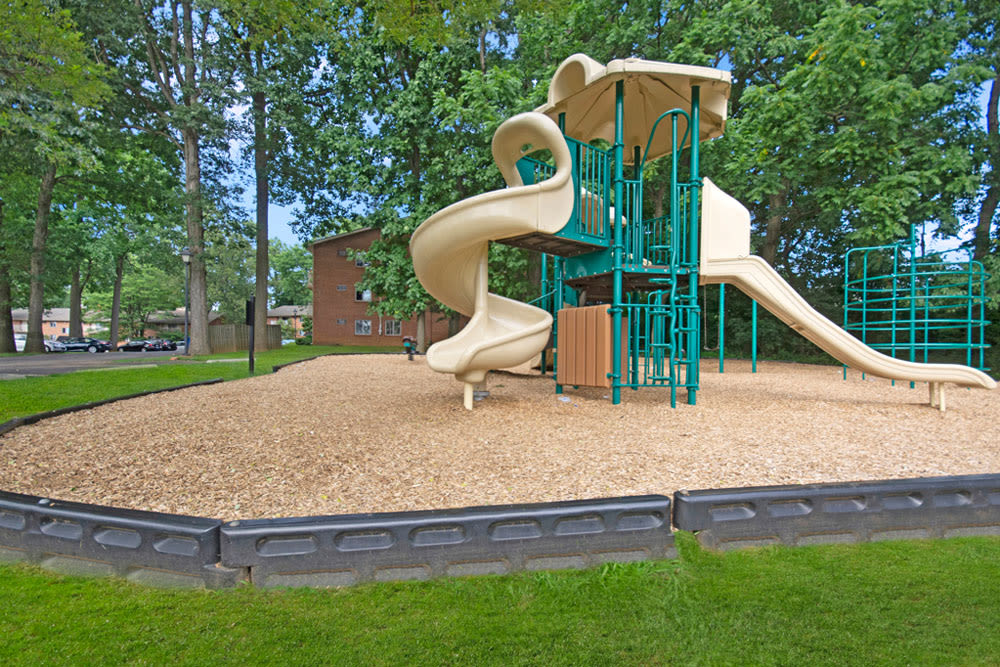 Playground equipment with bark chips base at Frazer Crossing in Malvern, Pennsylvania