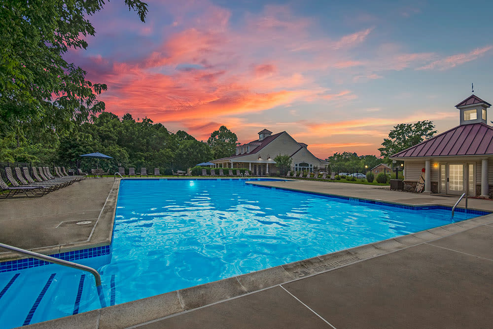 Beautiful orange colored clouds over community pool during sunset at Frazer Crossing in Malvern, Pennsylvania