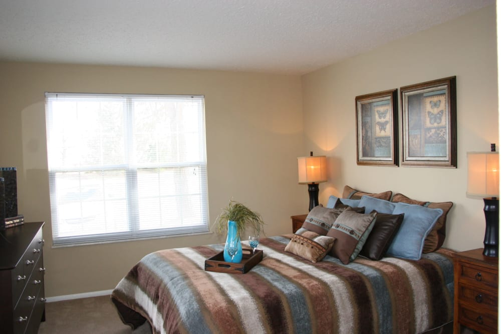 Well lit model bedroom at Oxford Hills in St. Louis, Missouri