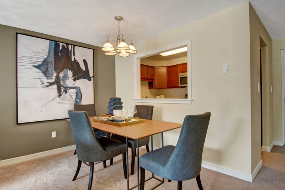 Dining room area with open wall giving into kitchen at Gardencrest in Waltham, Massachusetts