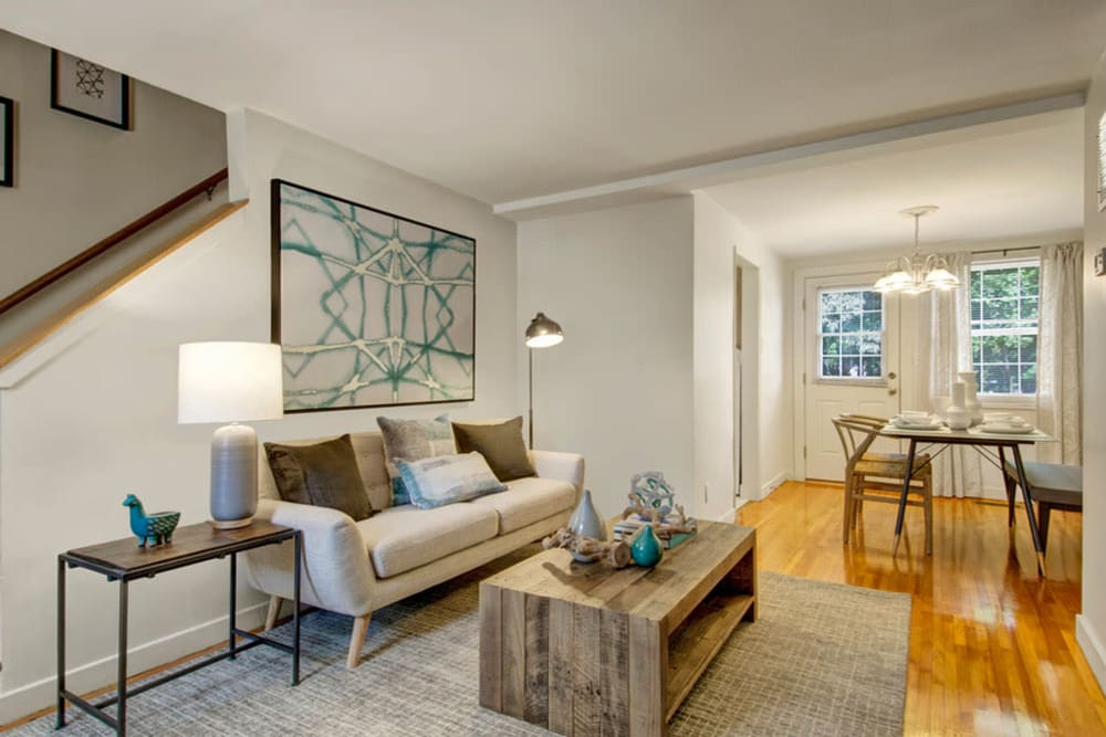 View of living room and dining space In an apartment at Gardencrest in Waltham, Massachusetts