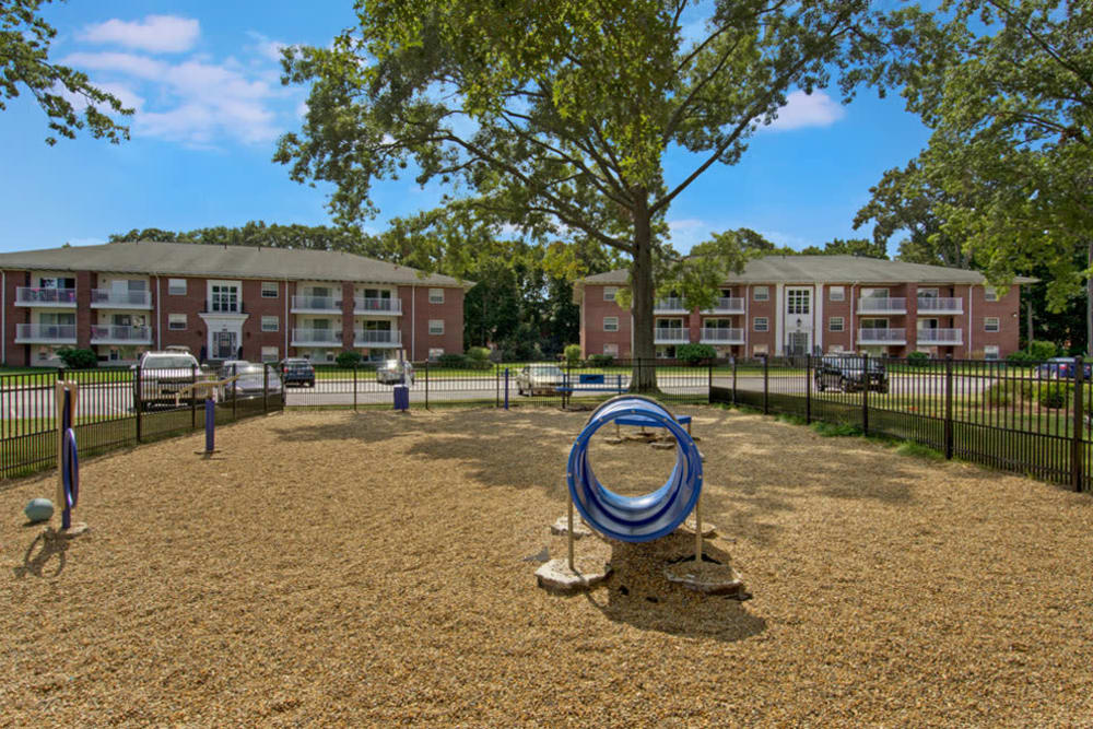 On-site dog park with agility equipment at Gardencrest in Waltham, Massachusetts