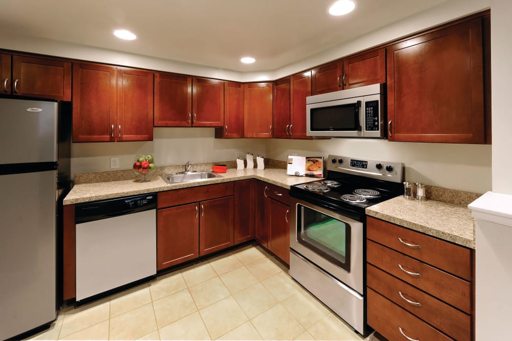 Spacious kitchen with plentiful storage and countertop space at Golf Club Apartments in West Chester, Pennsylvania
