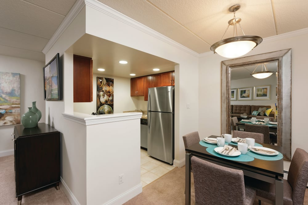 View of kitchen and dining area in an apartment at Golf Club Apartments in West Chester, Pennsylvania