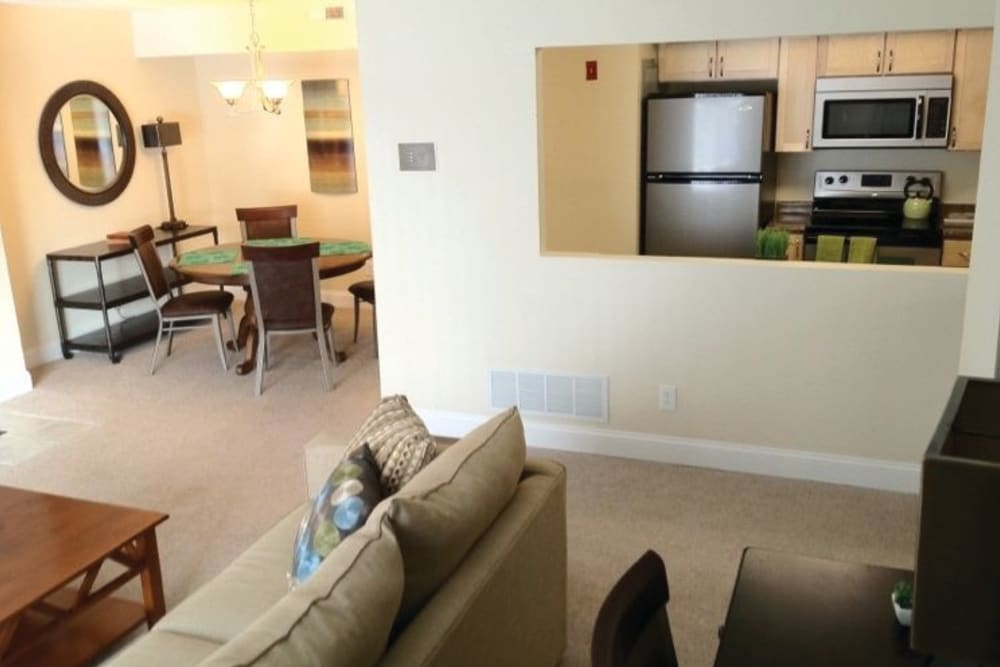 View of kitchen and dining area from a living room in an apartment at The Heights At Marlborough in Marlborough, Massachusetts