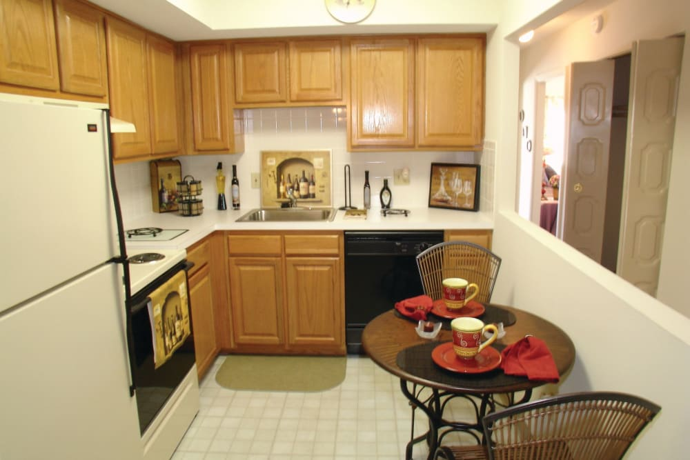 View of the kitchen with open space in wall by table in an apartment at The Heights At Marlborough in Marlborough, Massachusetts