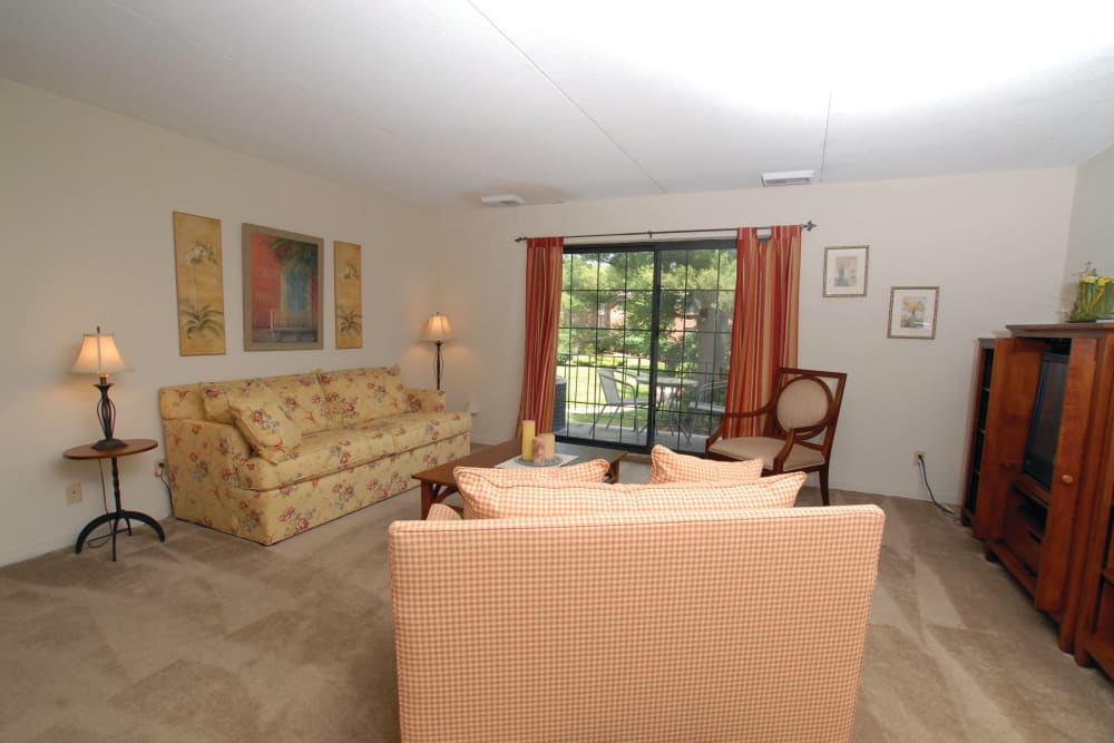 Loveseat and couch in a living room in an apartment at The Heights At Marlborough in Marlborough, Massachusetts