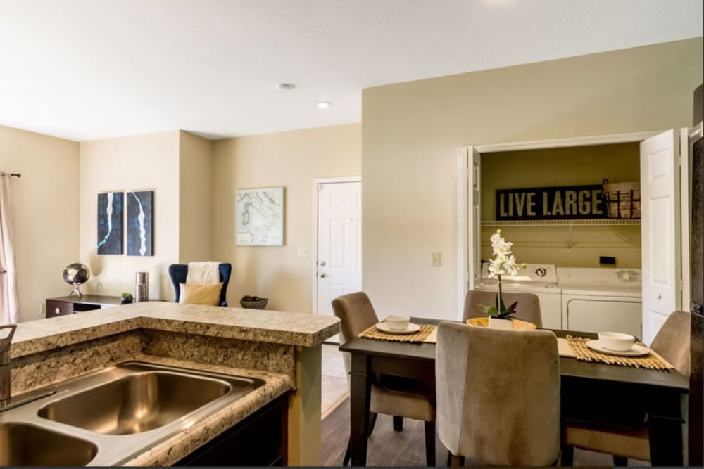View of the dining room table and living room from a kitchen at Heritage Green in Hilliard, Ohio