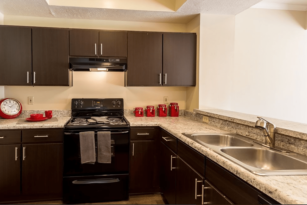 Kitchen featuring black appliances and ample countertop space at Heritage Green in Hilliard, Ohio
