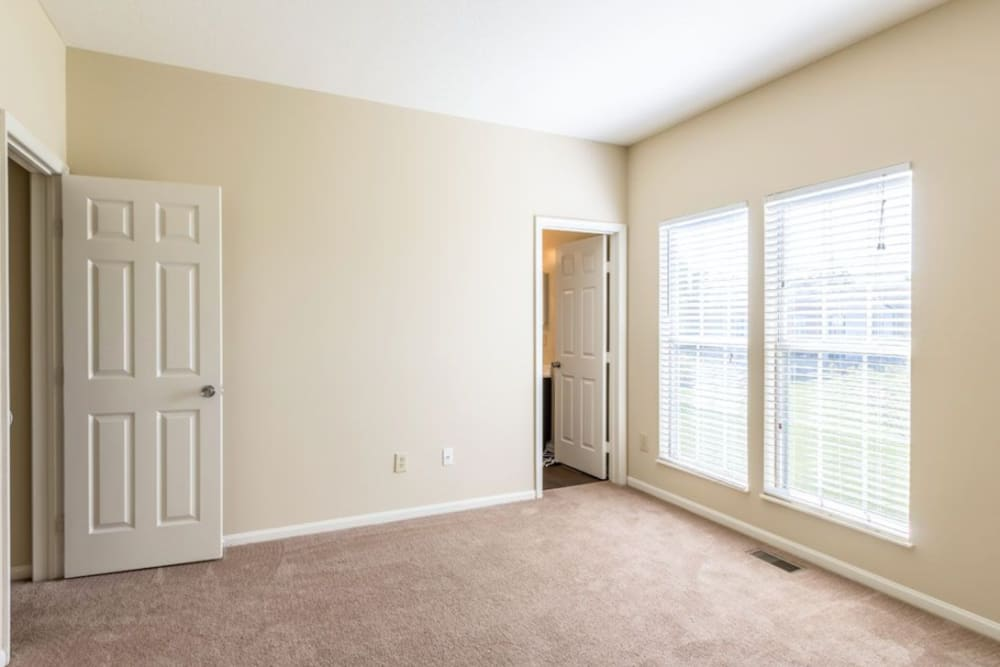 Bedroom featuring large windows at Heritage Green in Hilliard, Ohio