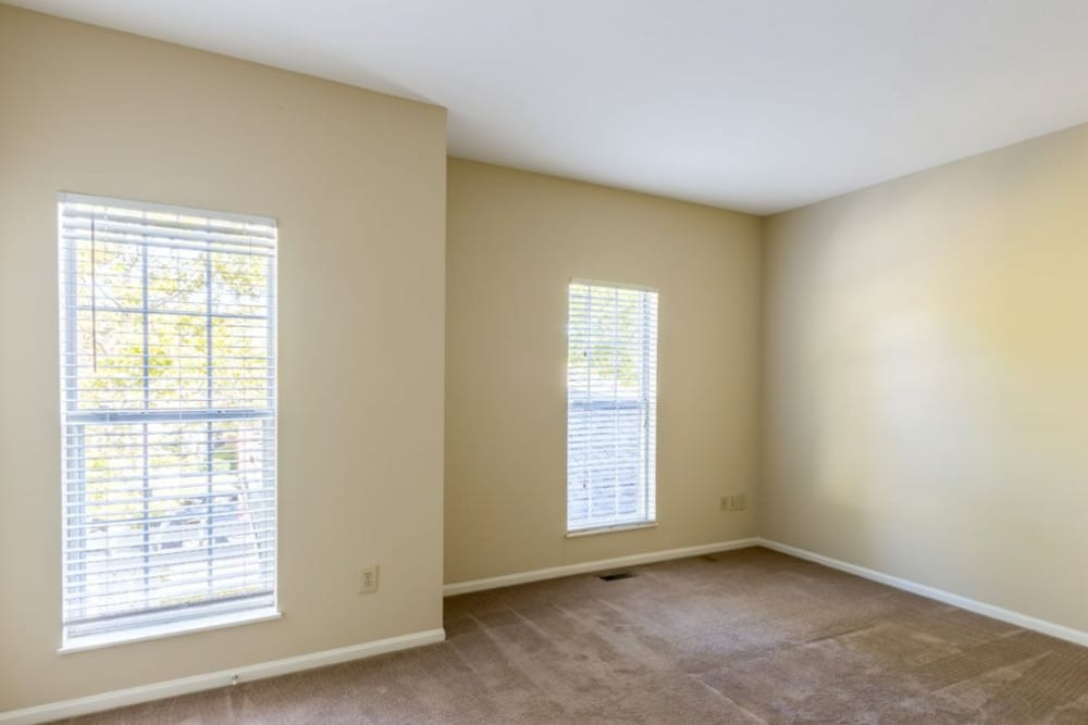 Spacious bedroom features large windows for ample natural light at Heritage Green in Hilliard, Ohio
