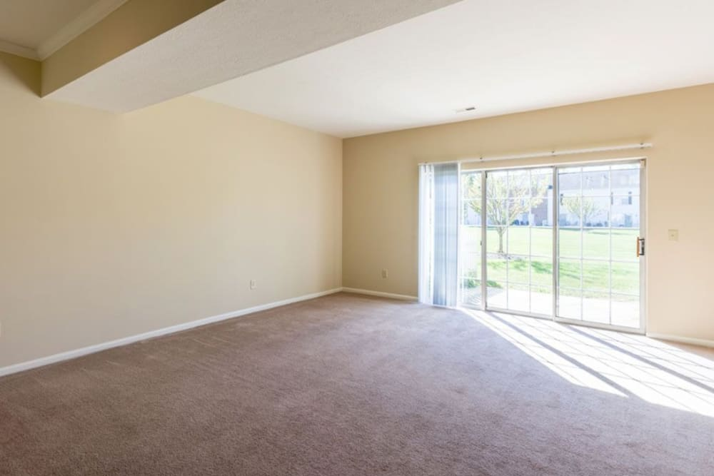 Large sliding glass doors leading to outside from living room at Heritage Green in Hilliard, Ohio