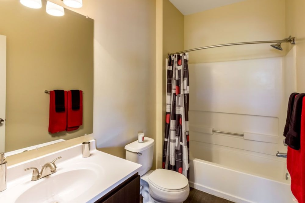 Bathroom featuring large vanity mirror and shower bathtub at Heritage Green in Hilliard, Ohio