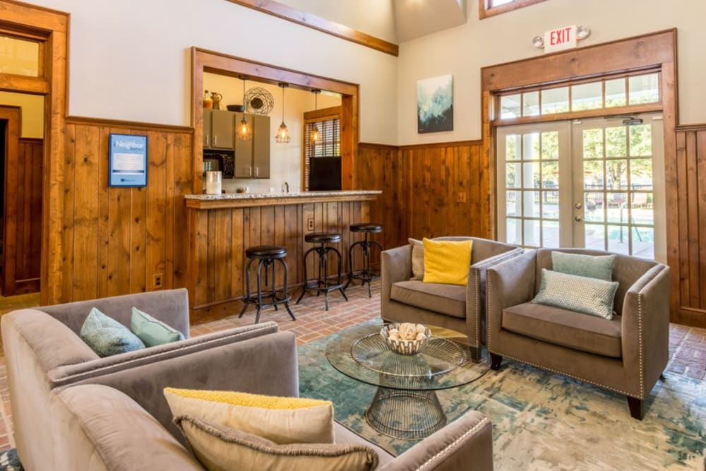 Clubhouse interior at Heritage Green in Hilliard, Ohio features fine wood finishes and a comfortable sitting area