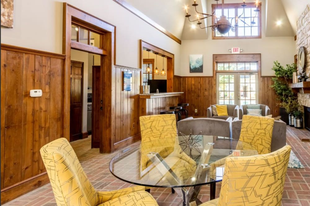 Bright yellow chairs at table in clubhouse at Heritage Green in Hilliard, Ohio