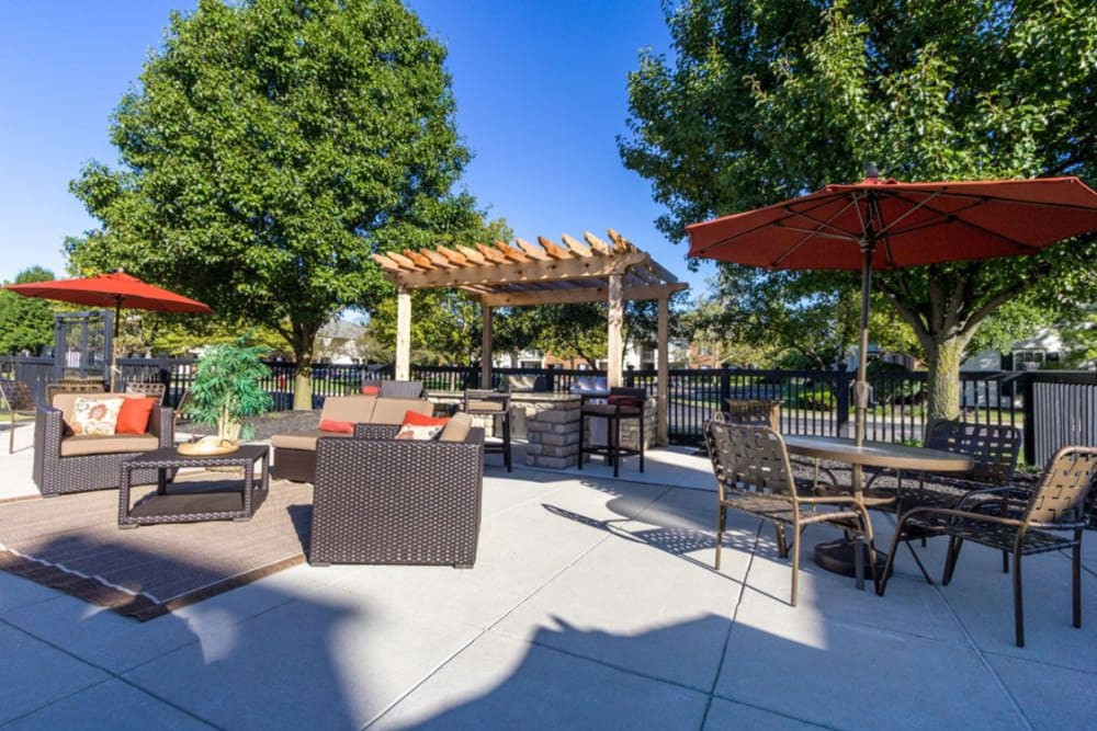 Community barbecue and sitting area by pool at Heritage Green in Hilliard, Ohio