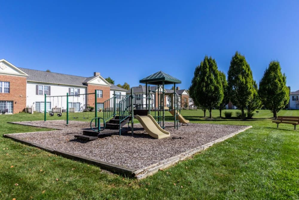 Play ground area with apartment buildings in the background at Heritage Green in Hilliard, Ohio