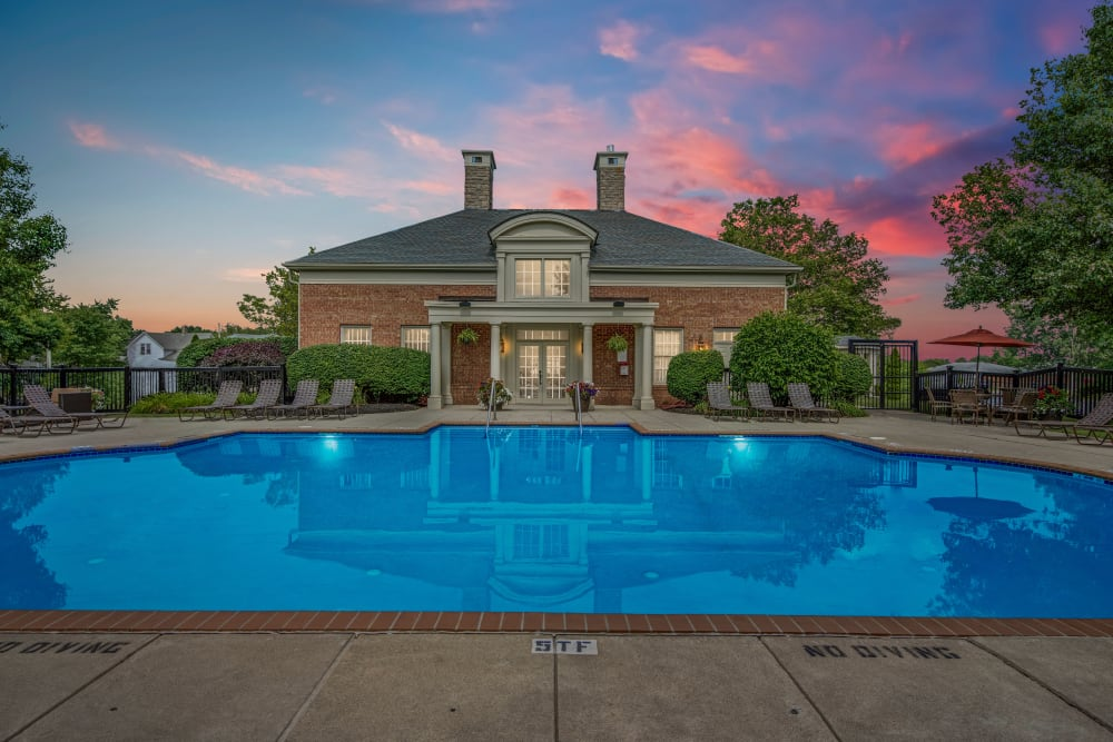 Beautiful sunset clouds over Clubhouse in the community swimming pool evening at Heritage Green in Hilliard, Ohio