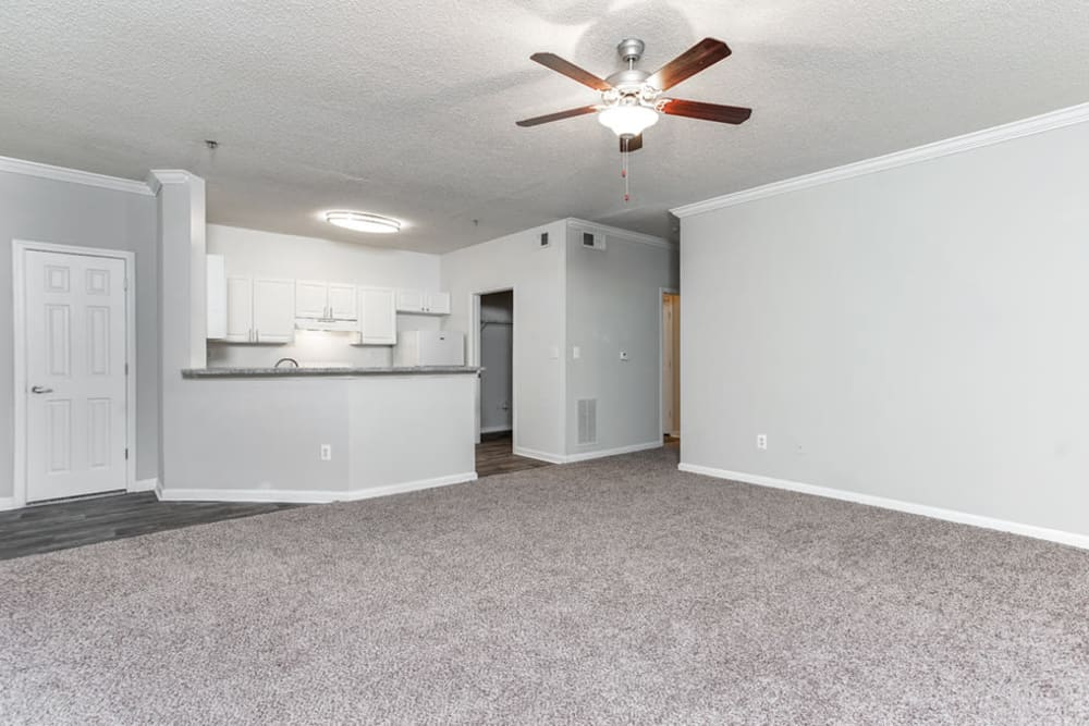 Spacious living room at Hidden Creek in Morrow, Georgia has a fan to help keep air circulating