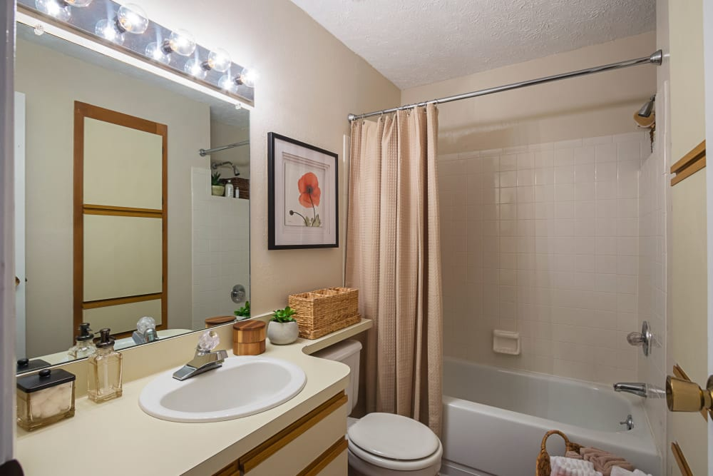 Bathroom with a shower and bathtub at Hickory Creek in Columbus, Ohio features a large vanity mirror