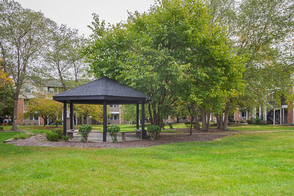 Gazebo shaded by large mature tree at Hickory Creek in Columbus, Ohio