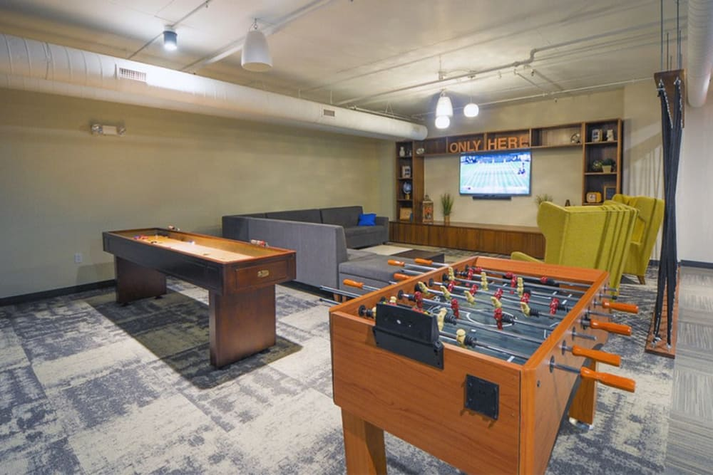 Game room with a foosball table at HERE Champaign in Champaign, Illinois