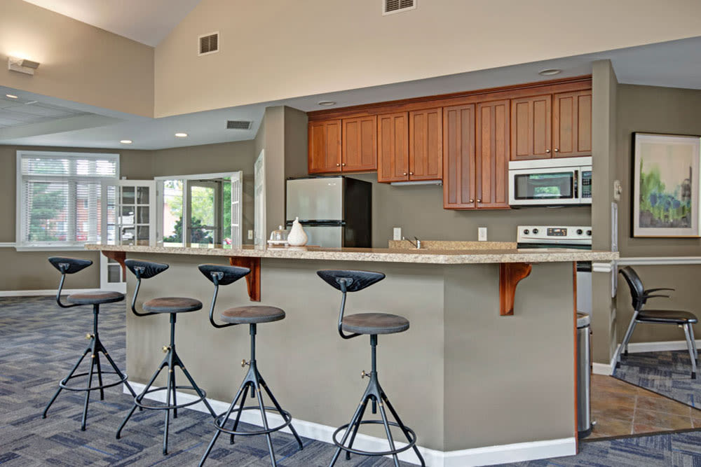 Clubhouse kitchen and coffee bar at New Orleans Park Apartments in Secane, Pennsylvania