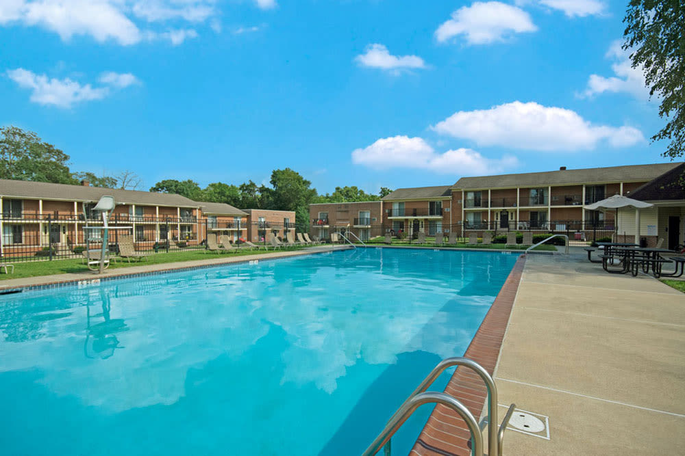 Pool with lounge chairs at New Orleans Park Apartments in Secane, Pennsylvania