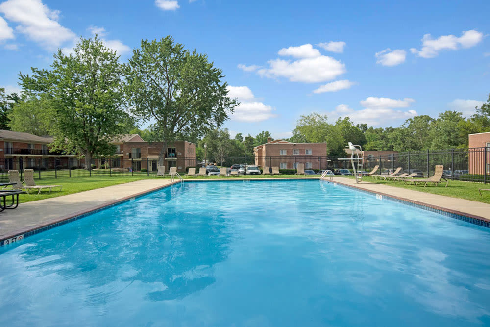 Resort style pool with lounge chairs at New Orleans Park Apartments in Secane, Pennsylvania