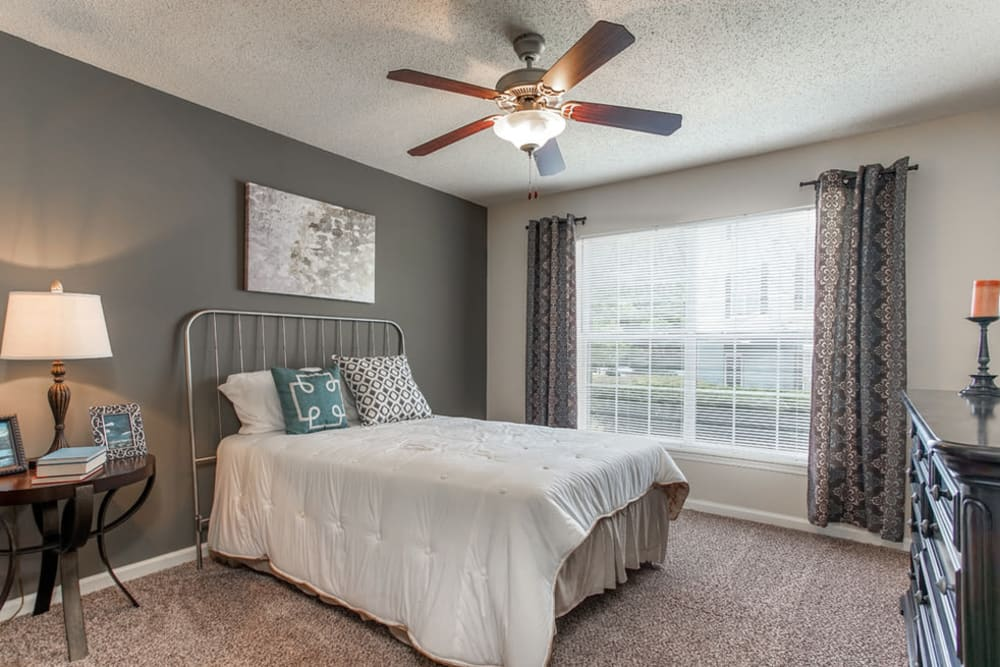 Model bedroom with ceiling fan at Monterey Village in Jonesboro, Georgia